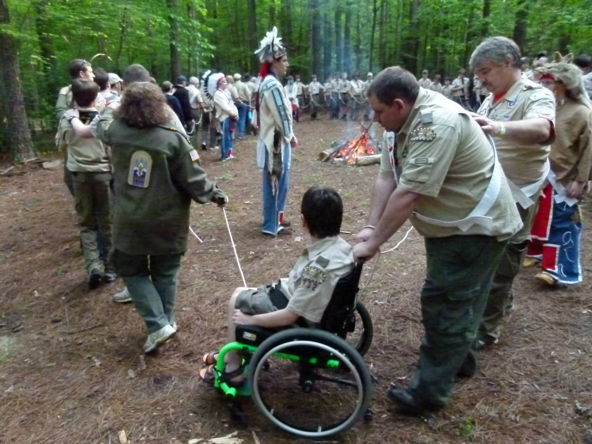 Michael Findlay helps his son, Sam, navigate the Ordeal Ceremony at Camp Sequoyah. (Photo: Jana Mayhall)